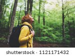 smiling tourist traveler with... | Shutterstock . vector #1121171432