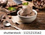 fresh hazelnuts ice cream on... | Shutterstock . vector #1121213162