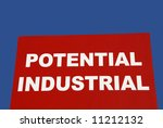 A sign advertising property for sale as potential industrial property - stock photo