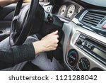 the girl starts the car by... | Shutterstock . vector #1121288042