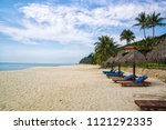 sand tropic palms and sunbeds.... | Shutterstock . vector #1121292335