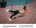 young woman workout on...   Shutterstock . vector #1121295785