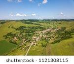 green hills near sibiu ... | Shutterstock . vector #1121308115