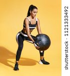 attractive woman workout with... | Shutterstock . vector #1121333492