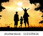 Happy family on sunset in nature - stock photo
