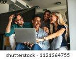 shot of a group of friends... | Shutterstock . vector #1121364755
