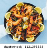 spanish seafood paella  top view | Shutterstock . vector #1121398838