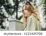 modern young woman standing on... | Shutterstock . vector #1121435708