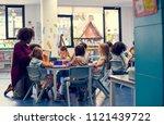 happy kids at elementary school | Shutterstock . vector #1121439722