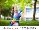 happy child holding traditional ...   Shutterstock . vector #1121442515