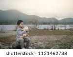 child asian with teddy bear...   Shutterstock . vector #1121462738