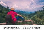 adventure man traveler sit on... | Shutterstock . vector #1121467805
