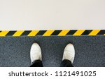 mind your step line on the... | Shutterstock . vector #1121491025