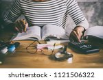 young student sitting at desk... | Shutterstock . vector #1121506322