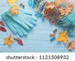 blue gloves and autumn leaves... | Shutterstock . vector #1121508932