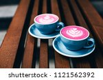 two trendy beetroot lattes with ... | Shutterstock . vector #1121562392