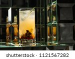 lemonade cocktail on a mirror... | Shutterstock . vector #1121567282