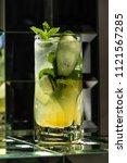 lemonade cocktail on a mirror... | Shutterstock . vector #1121567285