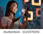 a young beautiful asian woman... | Shutterstock . vector #1121570252