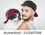 hipster guy hugging his nice... | Shutterstock . vector #1121607248