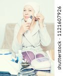 Small photo of Mature woman getting face cleaned with ultrasonic device at home