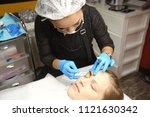 professional beautician asian... | Shutterstock . vector #1121630342