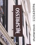 Small photo of Copenhagen, Denmark - June 26, 2018: Nespresso coffee house store logo on shop panel. Nespresso Nestle group brand has a presence in over 60 countries.