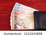 canadian money in the black... | Shutterstock . vector #1121641808