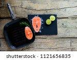 two salmon steaks are ready to... | Shutterstock . vector #1121656835