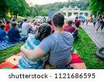 people watching movie in open...   Shutterstock . vector #1121686595