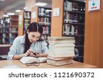 asian woman reading book in... | Shutterstock . vector #1121690372