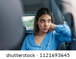 sad young woman looking through ... | Shutterstock . vector #1121693645