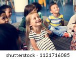 happy kids at elementary school | Shutterstock . vector #1121716085
