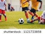 young junior football match.... | Shutterstock . vector #1121723858