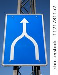 Small photo of Blue and White Traffic Merge Sign