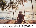 tourist in luxury beach hotel... | Shutterstock . vector #1121784215