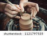 master removes the top layer of ... | Shutterstock . vector #1121797535