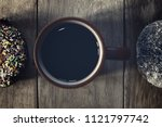 black coffee and donuts on... | Shutterstock . vector #1121797742
