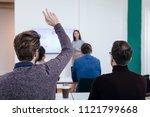 man raising hand in...   Shutterstock . vector #1121799668