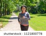 Smiling Woman Jogging Towards...
