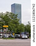 Small photo of Munich, Germany - June 09, 2018: The O2 Tower in Munich. Street in Munich. Munich Street with cars.