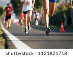 marathon running in the light...   Shutterstock . vector #1121821718