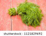 parsley bunch on wooden table... | Shutterstock . vector #1121829692