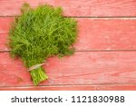 parsley bunch on wooden table... | Shutterstock . vector #1121830988