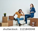 empty boxes and happy young... | Shutterstock . vector #1121843048