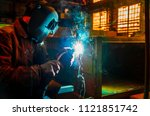 the worker in overalls and a... | Shutterstock . vector #1121851742