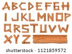 alphabet made of wooden letters ... | Shutterstock .eps vector #1121859572