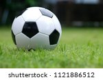 football is on the green field. | Shutterstock . vector #1121886512
