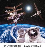 space statation and spacecraft. ... | Shutterstock . vector #1121895626