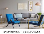 two blue armchairs and a gray... | Shutterstock . vector #1121929655